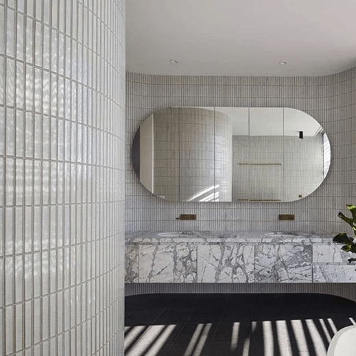 Yuki border white  by inax tile in a bathroom wall. high quality japan artisan tiles made by hand.