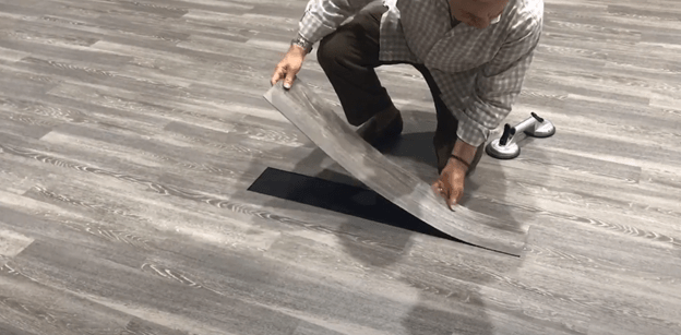 raffoul ajami founder of ajami surfaces using magentic flooring to replace the floors